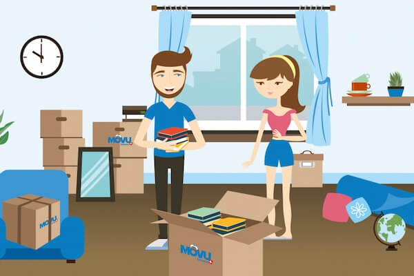 Two people packing moving boxes