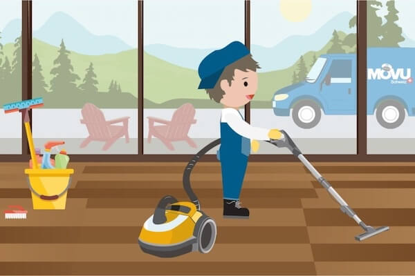 A person is cleaning the apartment with the vacuum cleaner